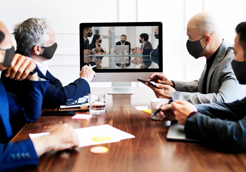 Business people wearing masks in coronavirus meeting, the new normal